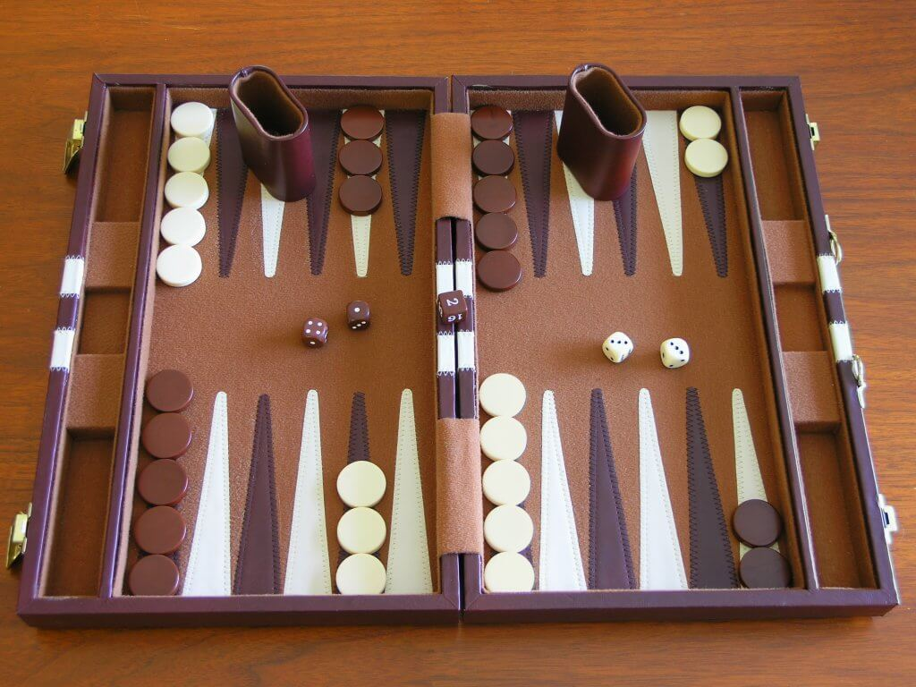 Backgammon playing board with counters