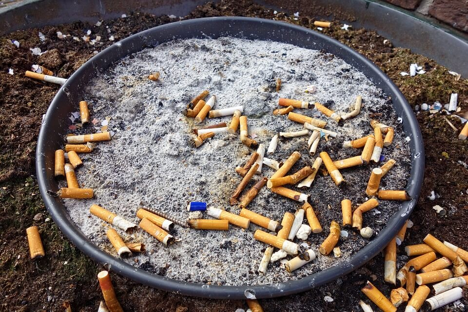 Cigarettes in an Ash Tray outside a pub
