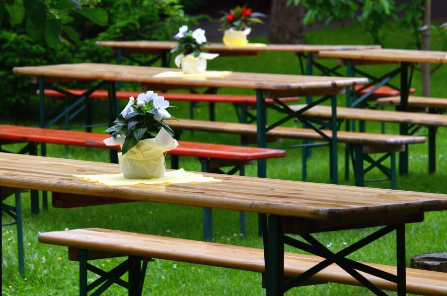 beer garden benches with flower displays