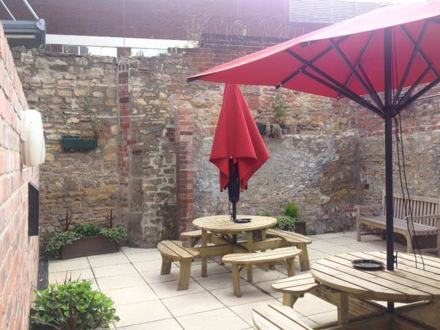 pub patio area with umbrellas and benches