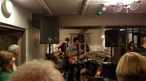 band playing a packed out pub